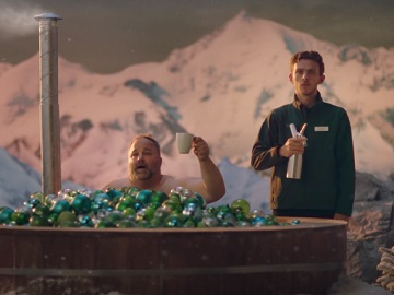 Dobbies Advert: Man in Tub Filled with Christmas Baubles